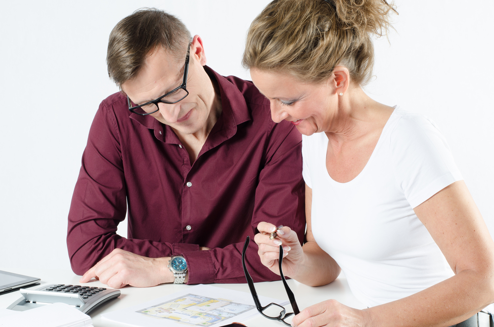 couple looking at floor plans for new place