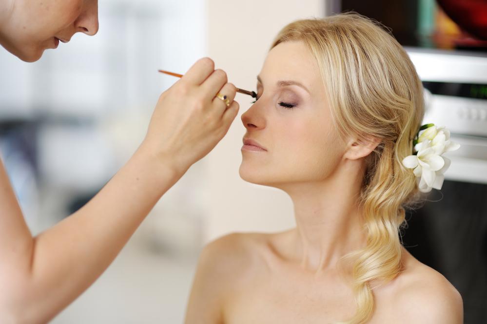 Makeup artist doing a bride's makeup