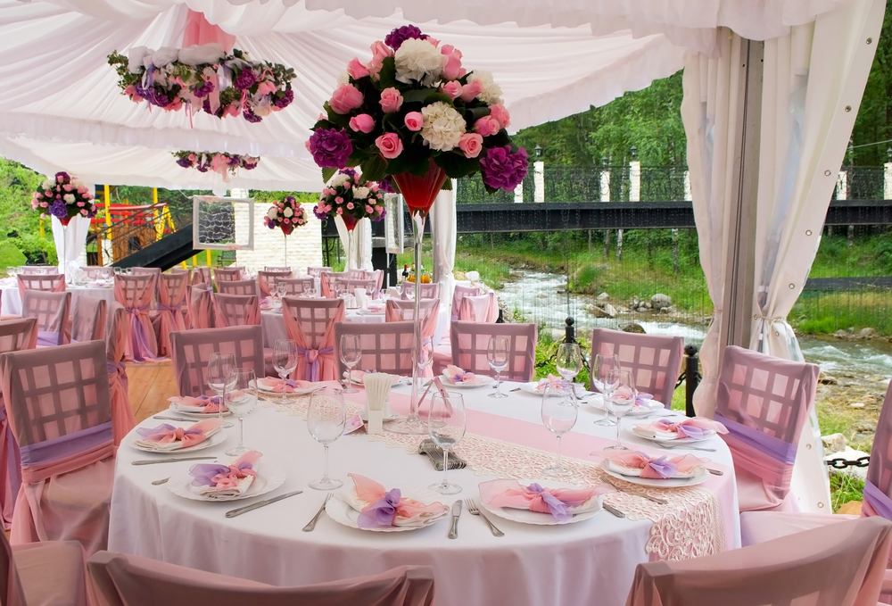 Wedding reception table with tall pink flowers