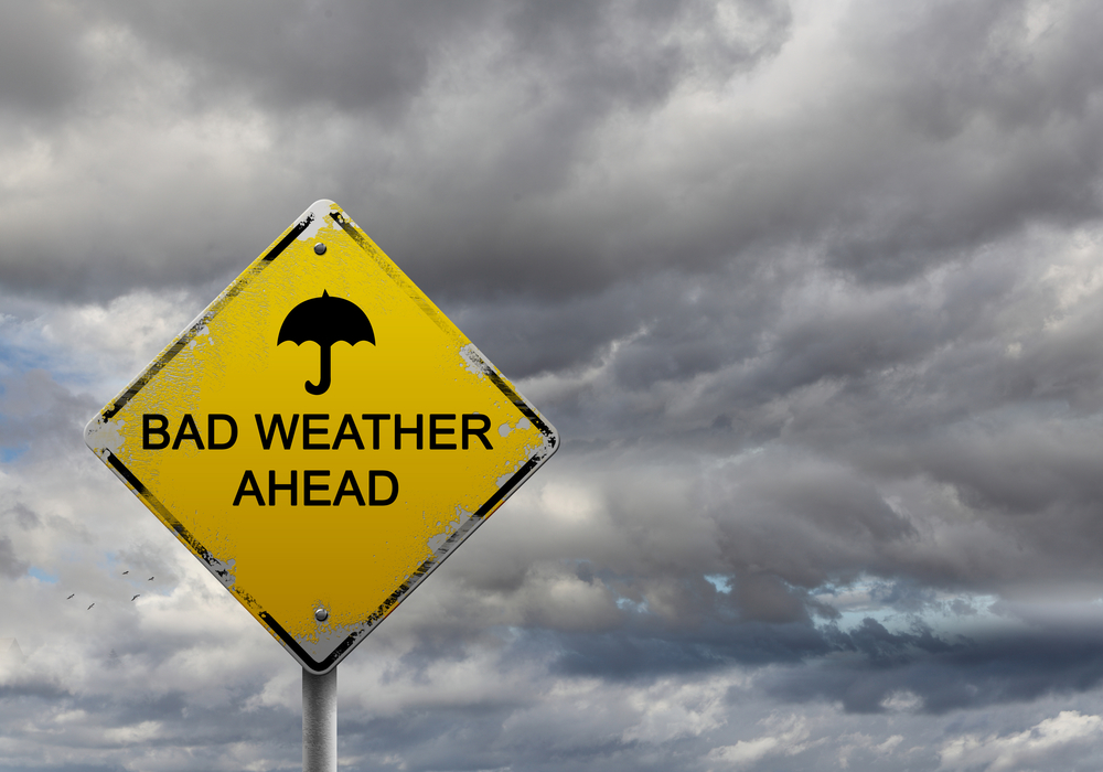 "Sign with bold letters saying: ""Bad Weather Ahead"""