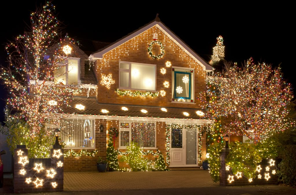 Exterior home with christmas lights and decoration