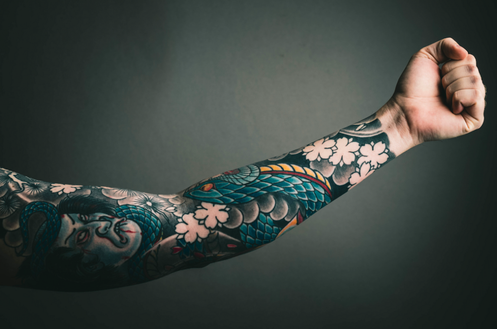 Best tattoos For business professionals, tattoos in the workplace 2020, business professionals with tattoos, workplace discrimination, business attire, office worker
